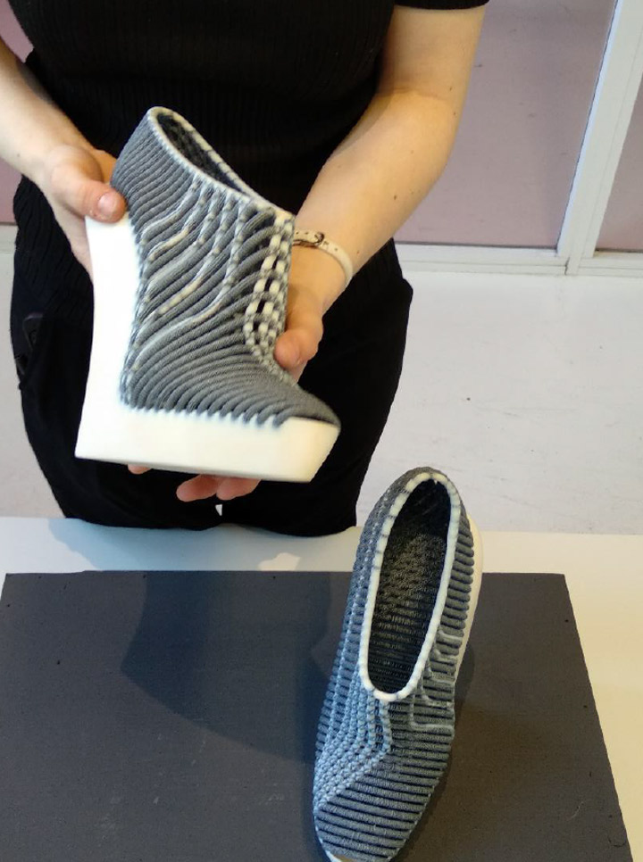 3abb55d5d436 Ganit Goldstein showcasing a pair of 3D-printed shoes she created in  collaboration with Stratasys Source  Coresight Research