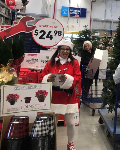 Mrs. Santa greeting customers