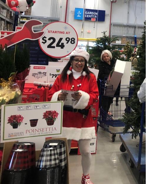 Mrs. Santa greeting customers